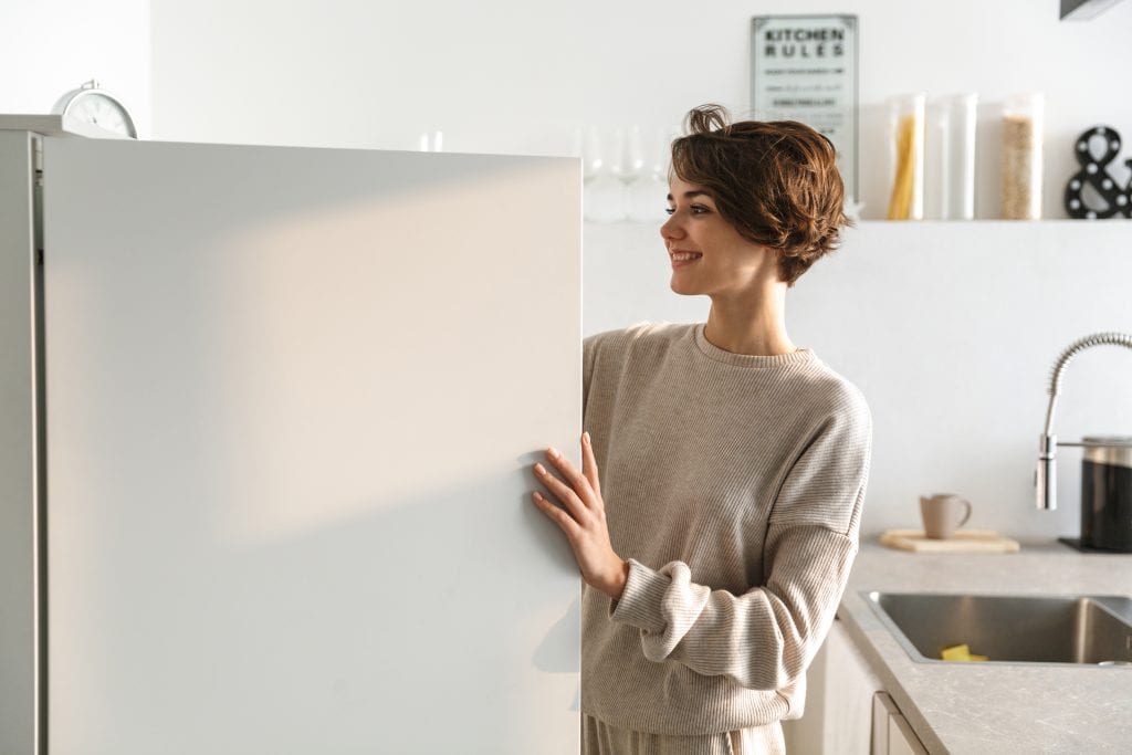 Woman looking into a fridge