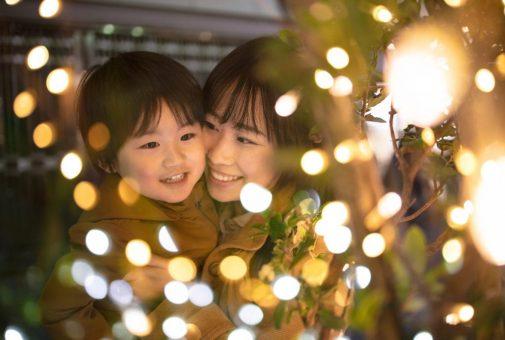 Mother and son enjoying Christmas lights