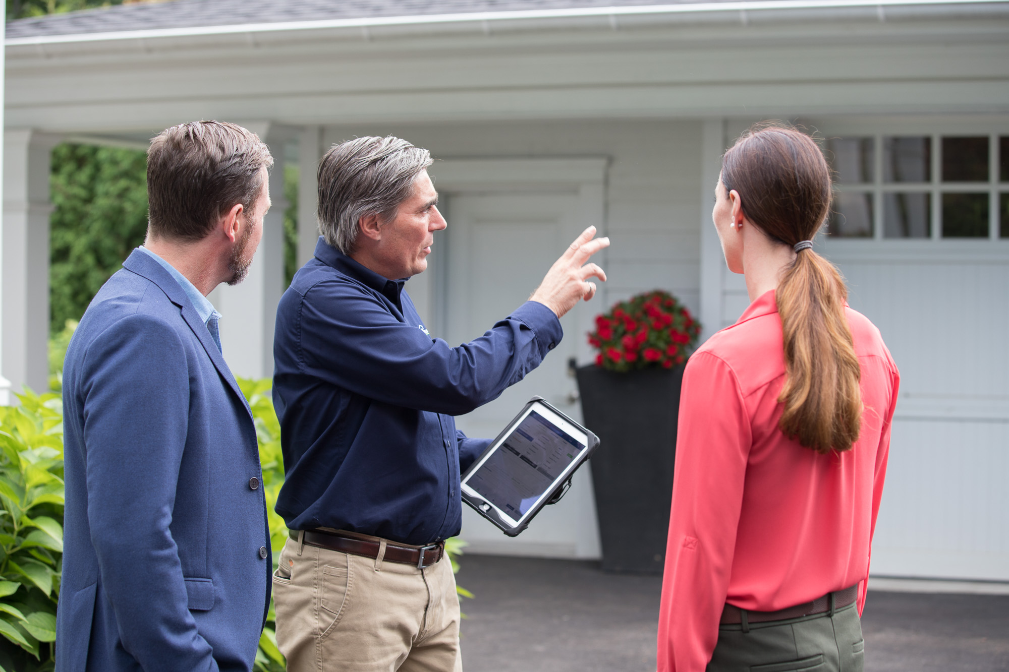 Home Inspector with Home Buyers